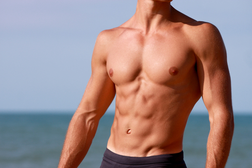 Man with Fit Torso on Beach