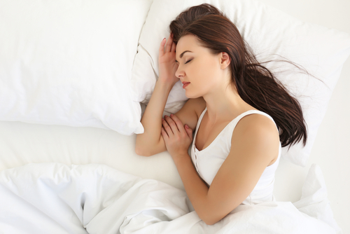attractive woman sleeping in white bed-img-blog