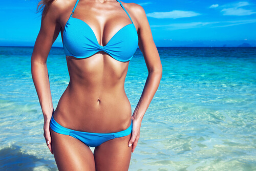 pretty slim girl at tropical sea beach-img-blog