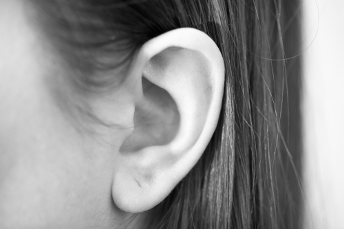 Model Womans ear from close perspective for otoplasty procedure