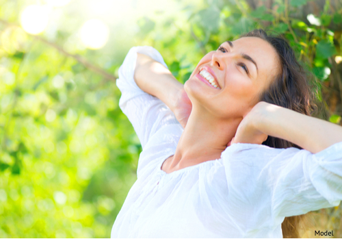 Woman enjoying spring with smooth skin and no wrinkles.